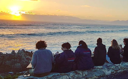 Marine Dynamics Academy volunteers enjoying a stunning African sunset